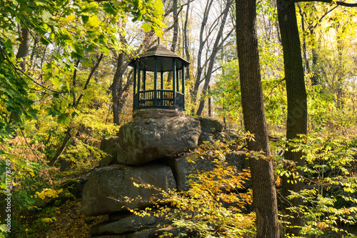 Fotomural Autumn landscape with summer house and yellow trees, Sofievka park, Uman, Ukrain