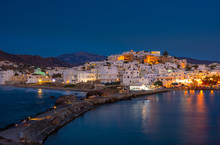 Chora Of Naxos Island As Seen From The Famous Landmark The Portara With The Natural Stone Walkway Towards The Village, Cyclades, Greece.