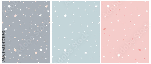 Obraz Tiny Stars Vector Patterns. Irregular Hand Drawn Simple Starry Sky Print for Fabric, Textile, Wrapping Paper. Infantile Style Galaxy Design. Little Stars Isolated on a Gray, Blue and Pastel Pink.  - fototapety do salonu