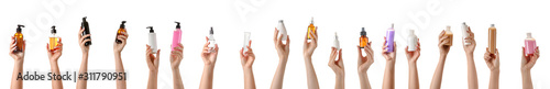 Obraz Female hands with different cosmetic products in bottles on white background - fototapety do salonu