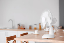 Electric Fan On Table In Kitchen