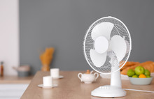 Electric Fan On Table In Kitchen