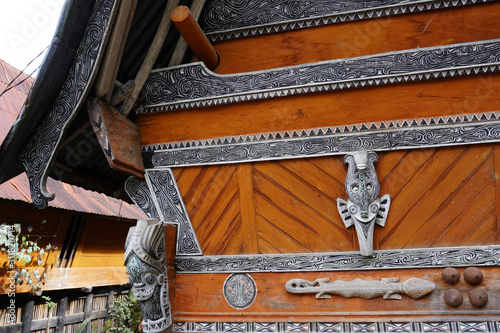 Batak carving on the wall of the village in the area of the Toba lake Wallpaper Mural