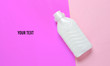 canvas print picture - Bottle of washing gel on a pastel colored background. Top view. Minimalism
