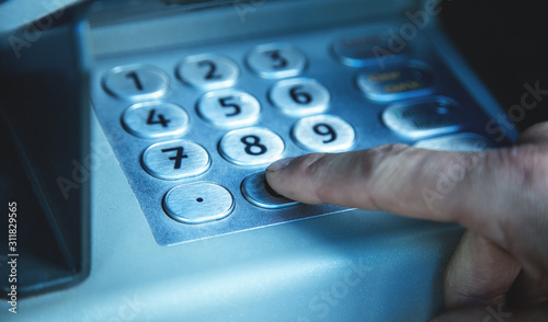 Man hand pressing on ATM machine keypad. ATM. Withdraw money Canvas Print