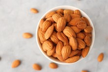 Almonds In White Bowl On Table. Almond Food Or Ingredient Concept With Copy Space