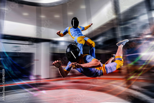 Fototapety, obrazy: Jump. Free fall in open air. Sky jump like a hobby of extreme people. Flying men make professional jump. Skydiver in blue and yellowsuit. Extreme as a hobby.