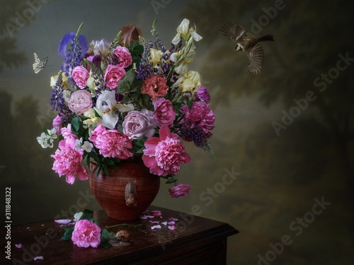 Still life with bouquet of flowers in a vase on wooden table Wallpaper Mural