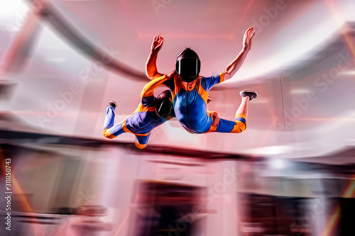 Fototapety, obrazy: Up. Fly men is a pilot of his body in air. Extreme people prefer skydiving. Parachutist in blue and yellow suit. Free lifestyle.