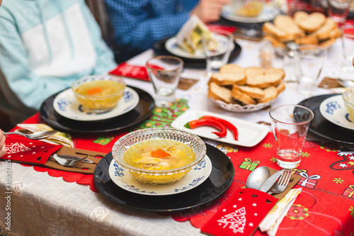 A Christmas meal in the family is served with Piftie or Racitura Wallpaper Mural