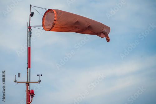 red-and-white wind designator designed to indicate the direction and approximate Canvas Print