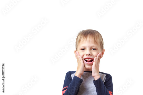 A six-year-old boy does articulation exercises for the development of speech on white background Canvas Print