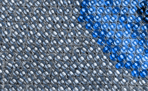 Macro photo of blue and gray beadwork. Canvas Print