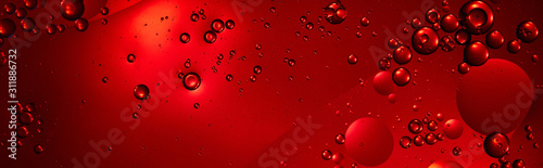 panoramic shot of creative red color background from mixed water and oil bubbles