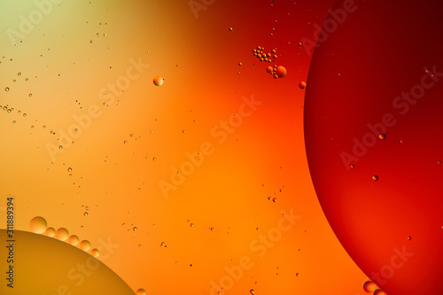 Beautiful abstract background from mixed water and oil in orange and red color