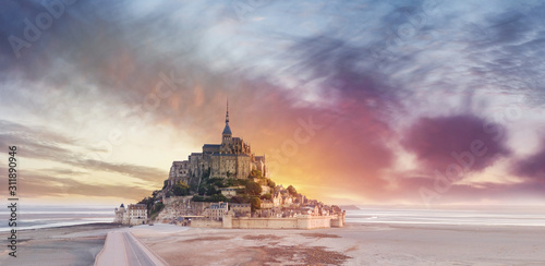 Le Mont Saint Michel tidal island in beautiful twilight at dusk, Normandy, France shot from aerial perspective - 311890946