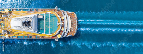 Fotografering Aerial view of beautiful white cruise ship above luxury cruise close up at stern of cruise sail with contrail in the ocean sea  concept smart tourism travel on holiday take a vacation time on summer