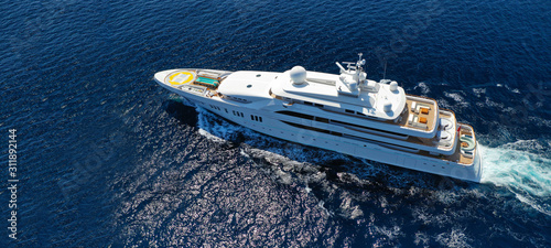 Fotomural Aerial drone ultra wide photo of luxury mega yacht with wooden deck cruising Aeg