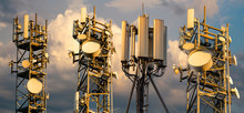Base Stations And Mobile Phone Transmitters Against The Background Of The Evening Sky.