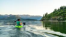 Active Couple Doing Kayak At S...
