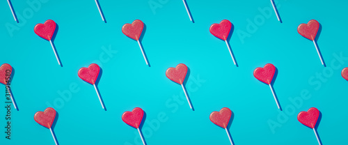 Photographie Flat lay heart shape lollipop on stick pattern Valentine day background