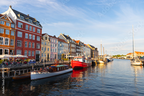 Colorful houses and boats in the canals of Nyhavn district, Copenhagen, Denmark Wallpaper Mural