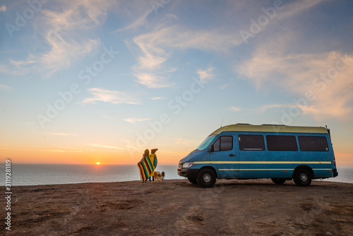 Camper van near ocean sunset Canvas Print