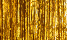 Party Background. Decor Made Of Gold Foil, Tinsel And Candy. Festive And Cheerful Mood