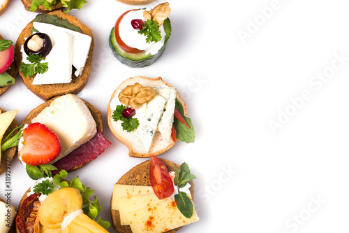 Canvas Print many different canapes on a white background