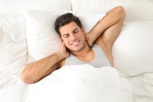 Man Awakening In Bed At Home, ...