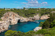 The beautiful coast shore of the island Mallorca in spain with a yacht in a scenic bay