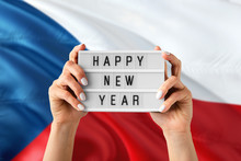 Czech Republic New Year Concept. Woman Holding Happy New Year Sign With Hands On National Flag Background. Celebration Theme.