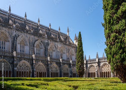 Ornate arches around the cloisters at the Batalha Monastery near Leiria in Portu Canvas Print