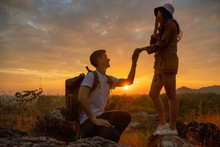 Silhouette And Soft Focused Of Man Having Married Engagement Proposal To Woman During Romantic Moment Of Sunset Outdoors