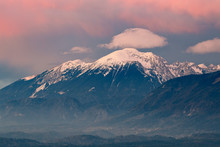 Mountain Peeks Of  Karavanke Range Alps Just Before The Sunset, With The Afterglow Lit Sky Viewed From Kranj, Slovenia