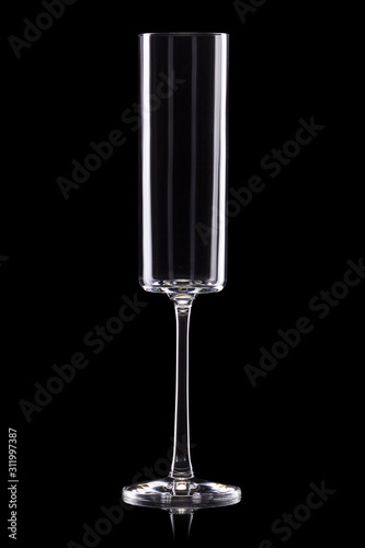 Empty luxury champagne glass isolated on a black background