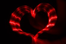 Red Heart On Black Background Made From Light Trails