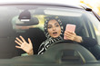 young muslim woman writes message on phone before car accident