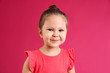 canvas print picture - Portrait of cute little girl on pink background
