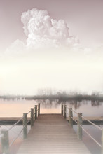 Travel Photography, Misty Morning Landscape Side View With A River, A Pier And A Large Cloud In Pastel Colors Close Up