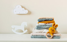 Baby Clothes On The Shelf In The Kids Room
