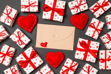 Top View Of Colorful Valentine Background Made Of Craft Envelope, Gift Boxes And Red Textile Hearts. Valentine's Day Concept