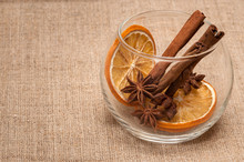 Composition From Spices: Dried Orange, Anise, Cinnamon. On Linen Cloth Background