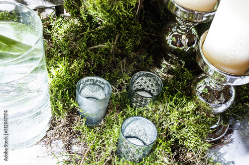 Fotografie, Tablou  Three water glasses on green grass