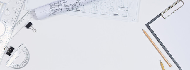 Architectural plans, pencil and ruler on the table. Working surface. Place for your text. View from above.