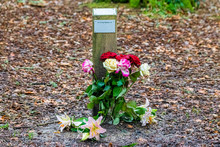 Roses And Lilies Left In Memoriam