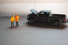 Miniature People, Car Mechanic Standing With Breakdown Pickup Truck Using As The Automotive Concept