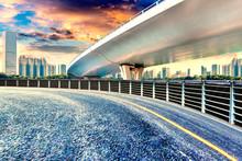 Empty Asphalt Road, Overpass And Modern Urban Architecture Sunset Landscape.