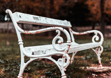 Lonely White Rusted Damaged White Park Bench In A Park In Split,croatia. Winter Autumn Cold Season Dramatic Dark Mood