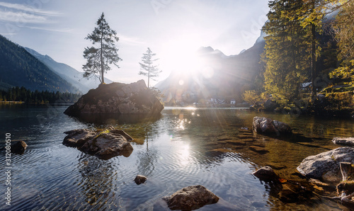 Wall mural - Wonderful Lake Hintersee in the Alps of Bavaria on a summer morning. Awesome alpine highlands in sunny day. Amzaing Nutere Scenery. Scenic image of fairy-tale woodland in sunlit.  Picture of wild area